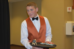 Student servers butler passed appetizers to gala guests while they enjoyed fundraising activities and networking.